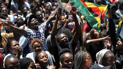 A man holding a flag of Zimbabwe takes part in a demonstration of University of Zimbabwe's students, on November 20, 2017 in Harare, to demand the withdrawal of Grace Mugabe's doctorate and refused to sit their exams as pressure builds on Zimbabwe's President Robert Mugabe to resign.Zimbabwe's President faced the threat of impeachment by his own party on November 20, 2017, after his shock insistence he still holds power in Zimbabwe despite a military takeover and a noon deadline to end his 37-year autocratic rule. / AFP PHOTO / -        (Photo credit should read -/AFP/Getty Images)