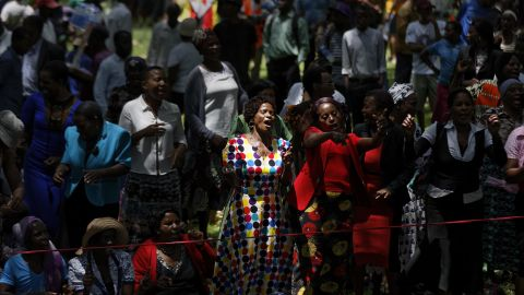 """Zimbabweans gather to pray for the country in a park opposite the parliament building in downtown Harare, Zimbabwe Tuesday, Nov. 21, 2017. Zimbabwean President Robert Mugabe should acknowledge the nation's """"insatiable desire"""" for a leadership change and resign immediately, the recently fired vice president and likely successor to the 93-year-old leader said Tuesday. (AP Photo/Ben Curtis)"""