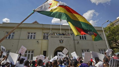 Demonstrators protest outside the Parliament building on November 21.