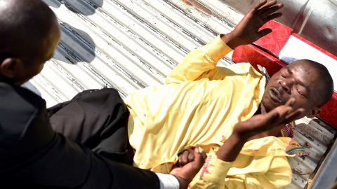 A man accused of supporting Mugabe is attacked outside Parliament on November 21.