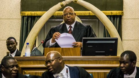 Jacob Mudenda, the speaker of Zimbabwe's Parliament, presides over a session where a motion was moved to impeach Mugabe.