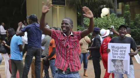Zimbabweans celebrate Robert Mugabe's resignation after 37 years of rule, in Harare on Tuesday.