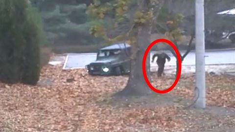 A North Korean defector darts across the DMZ dividing the two Koreas in this screenshot of handout video provided by the United Nations Command.