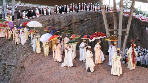Priest and deacons march in a processional around Beta Mariam Church in Lalibela, Ethiopia. Thousands of adherents to the Ethiopian Orthodox faith come here to observe Orthodox Christmas.