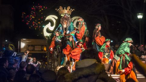 King Gaspar giving away sweets at the Three Kings Day parade in Terrassa, a town not far from Barcelona, Spain.