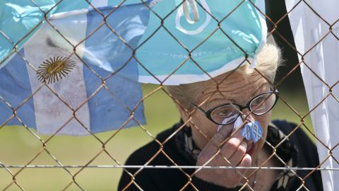 A woman cries outside the Mar del Plata naval base after learning that a sound detected during the search for the missing ARA San Juan submarine is consistent with that of an explosion.