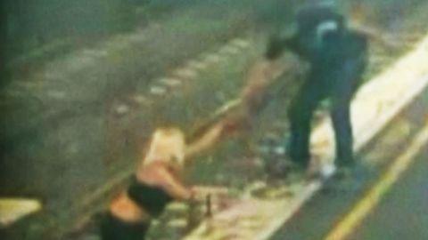 woman train track australia