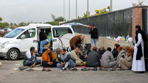 Relatives of the victims of the mosque attack sit outside a hospital Saturday in the eastern port city of Ismailia.