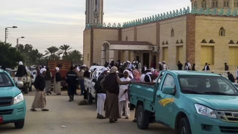 AL ARISH, EGYPT - NOVEMBER 24:  People gather at the site of the Egypt Sinai mosque bombing in Al-Arish, Egypt on November 24, 2017. The death toll from a bomb that went off outside a mosque in the city of Al-Arish in the northern Sinai Peninsula following Friday prayers has climbed to a whopping 235, according to official sources. At least 109 others were injured in the blast, which occurred in the citys Al-Rawda neighborhood.   (Photo by Stringer/Anadolu Agency/Getty Images)