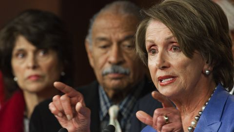"""US Representatives Lucille Roybal-Allard (L), D-CA, and John Conyers (C), D-MI, listen as US House Minority Leader Nancy Pelosi (R), D-CA, calls on Republicans to return to work because """"We Can't Wait"""" on the payroll tax cut extension and unemployment insurance bills, January 5, 2012 on Capitol Hill. Democrats are highlighting the GOP's one year aniversary leading the House of Representatives without a jobs agenda."""