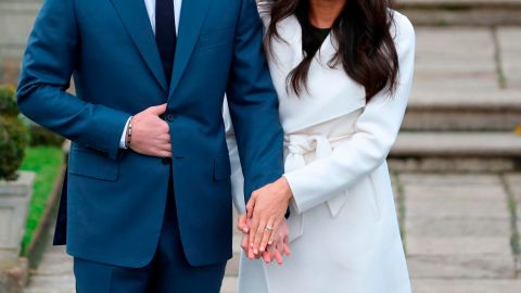 Meghan Markle shows off her engagement ring as she poses with Prince Harry at Kensington Palace on November 27.