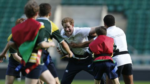 Harry plays rugby with children as he takes part in a coaching session in London in 2013.