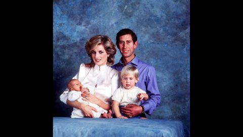 Harry is held by his mother during this family photo with his dad and his brother, Prince William, in 1984.