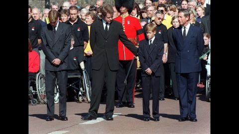 Princess Diana's brother, Earl Spencer, offers Harry a reassuring arm during her funeral service in 1997.