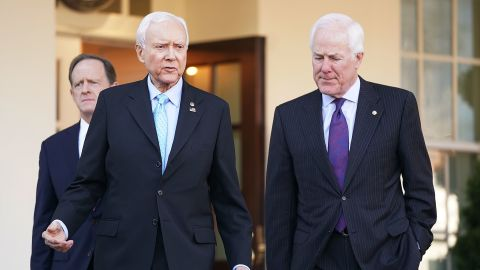 Senate Finance Committee members Sen. Pat Toomey (R-PA) (L) and Sen. John Cornyn (R-TX) (R) walk out of the West Wing with Chairman Orrin Hatch (R-UT) following a lunch meeting with U.S. President Donald Trump at the White House November 27, 2017 in Washington, DC. Senate Republicans hope to pass tax reform and tax cut legislation this week and move closer to Trump's goal of signing it before the end of the year.