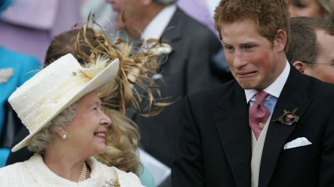 Harry and Queen Elizabeth II share a joke on his father's wedding day.
