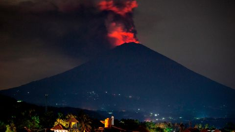 Mount Agung spews volcanic ash into the night sky on November 27,  near Karangasem, Bali, Indonesia.