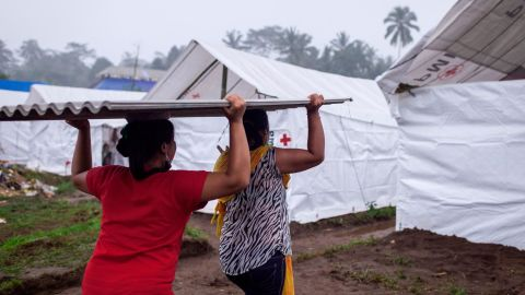 Evacuees unload building materials for  temporary shelters at Rendang Evacuation Center on November 27,  in Karangasem, Bali, Indonesia.