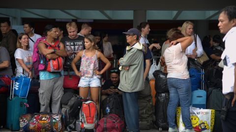 Passengers gather at the Ngurah Rai International Airport in Denpasar, Bali, on November 28, 2017, to wait for possible flights out after the Mount Agung volcano eruption.