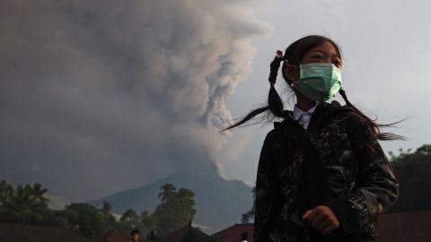 An elementary school student wears a face mask on school grounds before school in Karangasem, Bali, Indonesia, on November 28.