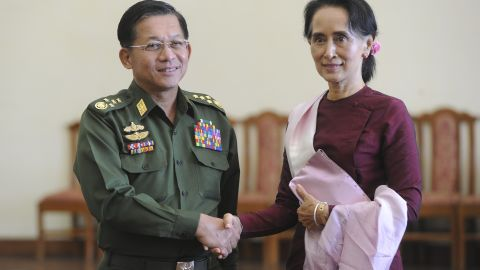 Senior General Min Aung Hlaing and Myanmar's de facto leader Aung San Suu Kyi shake hands at the Commander in-Chief's office in Naypyidaw on December 2, 2015.
