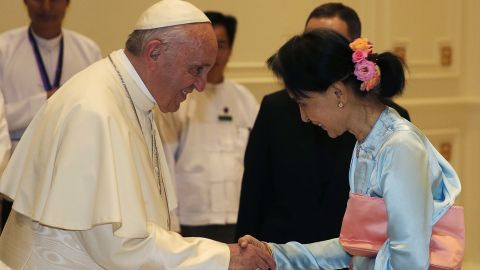 Pope Francis (left) shakes hands with Aung San Suu Kyi on Tuesday.