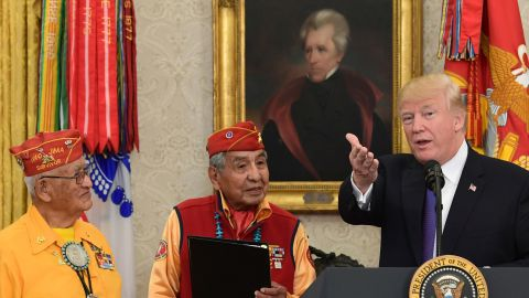President Donald Trump speaks during a meeting with Navajo Code Talkers Fleming Begaye Sr., seated left, Thomas Begay, second from left, and Peter MacDonald, second from right, in the Oval Office of the White House on Nov. 27.