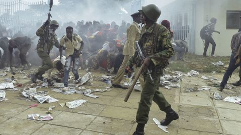 Police intervene during a stampede in Nairobi as supporters of Kenya's President try to get into his inauguration on November 28.