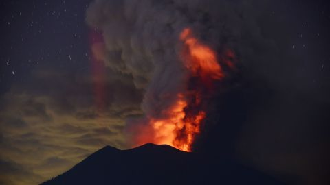 Smoke and ash is lit from within Mount Agung on November 28.