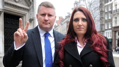 Paul Golding, leader of Britain First, and the party's deputy leader, Jayda Fransen, arrive at the Royal Courts of Justice in central London, where he is appearing in connection with an alleged breach of an injunction, relating to his activities around mosques. (Photo by Nick Ansell/PA Images via Getty Images)