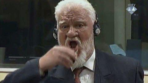 Crotian Former General Slobodan Praljak drinking a small bottle of liquid during a Yugoslav War Crimes Tribunal in The Hague on November 29.
