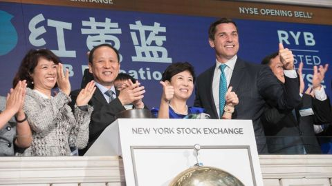 RYB Education representatives ring the New York Stock Exchange opening bell on the company's first day of trading in September.