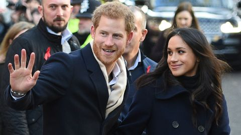 Britain's Prince Harry and his fiancee US actress Meghan Markle greet wellwishers on a walkabout as they arrive for an engagement at Nottingham Contemporary in Nottingham, central England, on December 1, 2017 which is hosting a Terrence Higgins Trust World AIDS Day charity fair. Prince Harry and Meghan Markle visited Nottingham in their first set of engagements together since announcing their engagement. / AFP PHOTO / Oli SCARFF        (Photo credit should read OLI SCARFF/AFP/Getty Images)