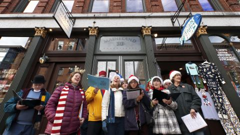 Members of the Portland Community Chorus sing holiday carols in downtown Portland, Maine.