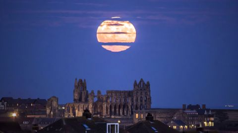 The supermoon rises above Whitby Abbey in Yorkshire, England.