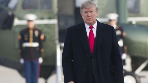 US President Donald Trump walks to Air Force One prior to departure from Andrews Air Force Base in Maryland, December 4, 2017, as Trump travels to Salt Lake City, Utah.