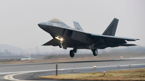 A US Air Force F-22 Raptor stealth jet takes off at a South Korean air base in Gwangju on December 4, 2017.