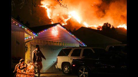 A man prepares to evacuate his house in Santa Paula, California, on December 5.