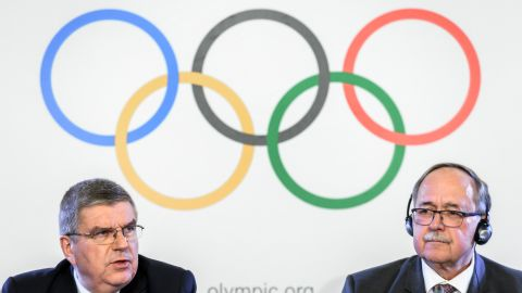 """International Olympic Committee (IOC) President Thomas Bach (L) and Chair of IOC Inquiry Commission into alleged Russian doping at Sochi 2014 Swiss Samuel Schmid attend a press conference following an executive meeting on Russian doping, on December 5, 2017 in Lausanne. Russia were banned from the 2018 Olympics on December 5 over state-sponsored doping but the International Olympic Committee said Russian competitors would be able to compete """"under strict conditions"""". / AFP PHOTO / Fabrice COFFRINI        (Photo credit should read FABRICE COFFRINI/AFP/Getty Images)"""