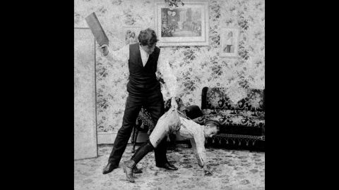 """The tools of spanking are varied. In this vintage image, a man uses a paddle. For adults administering punishment,<strong> </strong>the use of switches, belt straps, paddles and the like delivered increased punishment while saving their hands from the sting of the swat. <br />In the slave trade, there was a crueler reason for the use of a paddle or strap. In his book """"<a href=""""https://books.google.com/books?id=R-BAAAAAcAAJ&printsec=frontcover&pg=PA304#v=onepage&q&f=false"""" target=""""_blank"""" target=""""_blank"""">Flagellation and the Flagellants: A History of the Rod in all Countries from the Earliest Period to the Present Time</a>,"""" the Rev. William Cooper explains that straps were used to keep from scarring slaves and reducing their value: """"It is said that with this instrument a slave could be punished to within an inch of his life, and yet come out with no visible injury, and with his skin as smooth as a peeled onion."""""""