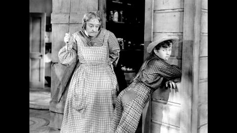 """Spanking was a common theme in pop culture. In Mark Twain's classic """"The Adventures of Tom Sawyer,"""" Aunt Polly, played in the 1938 movie by May Robson, frequently punishes Tom, played by Tommy Kelly, for playing hooky and other mischief."""