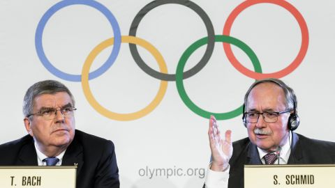 IOC President Thomas Bach (L) and Chairman of the IOC Inquiry Commission Samuel Schmid.