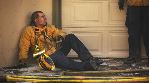 Ventura County firefighter Aaron Cohen rests on December 5.