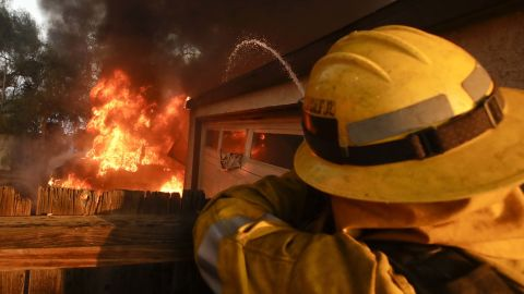 A firefighter sprays water at a burning house in the Lake View Terrace area of Los Angeles on December 5.