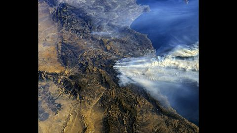 Smoke rises across Southern California in this image taken from the International Space Station on December 6.