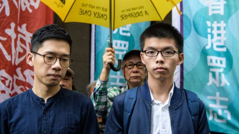 Joshua Wong (R) and Nathan Law arrive at the Court of Final Appeal for the first hearing in their bid to appeal their jail sentences in Hong Kong on November 7, 2017.
