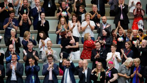 Members of the public, including Christine Forster and partner Virginia Edwards, react from the gallery in Parliament House after legislators passed the same-sex marriage bill on Thursday.