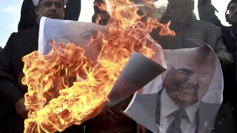 Palestinians burn posters of Israeli Prime Minister Benjamin Netanyahu and US President Donald Trump in Gaza on Thursday.