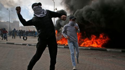 Palestinian demonstrators clash with Israeli troops during protests in Ramallah on December 7.
