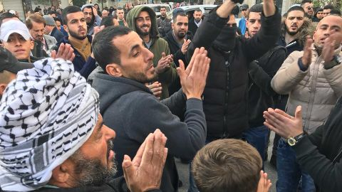 Protesters gather in al-Manara square in Ramallah on Thursday morning.